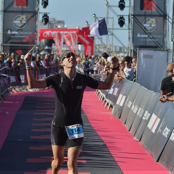 Crossing the finish line at Ironman Italy